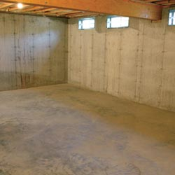 A cleaned out basement in Wilmington, shown before remodeling has begun