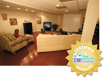 A remodeled basement with the Total Basement Finishing badge