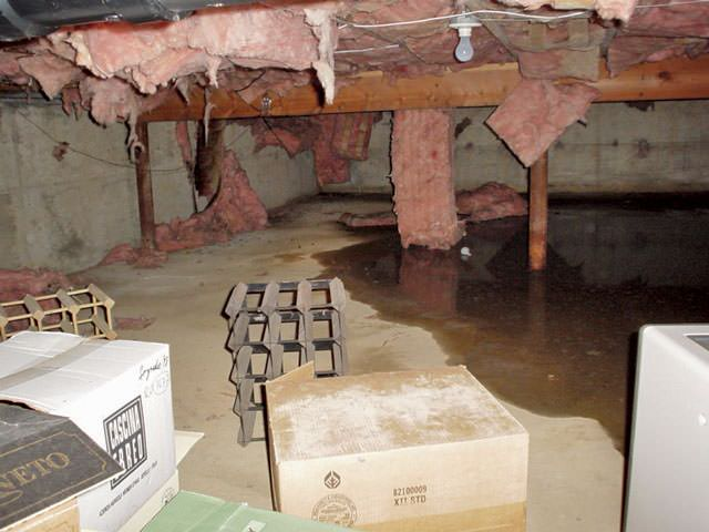 as fiberglass insulation becomes soaked with moisture in a crawl space