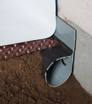 Closeup of a crawl space drainage system installed in Landenberg
