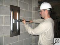 Straighten a bowed foundation wall by wall anchor system