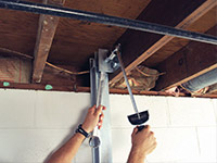Straightening a foundation wall with the PowerBrace™ i-beam system in a Haverford home.
