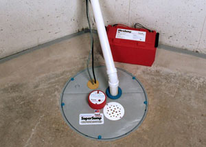A sump pump system with a battery backup system installed in Media