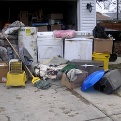Soaked, wet personal items sitting in a driveway, including a washer and dryer in Lancaster.