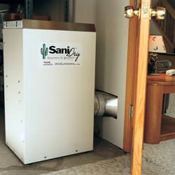 A basement dehumidifier with an ENERGY STAR® rating ducting dry air into a finished area of the basement  in Phoenix
