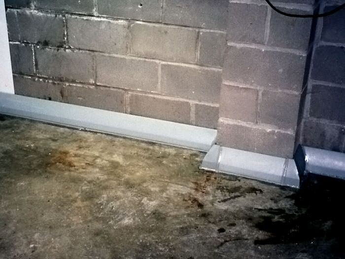 Baseboard Basement Drain Pipe System In Greater