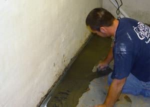 Restoring a concrete slab floor with fresh concrete after jackhammering it and installing a drain system in Thornton.