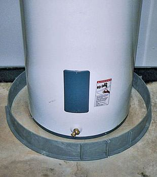 An old water heater in Windsor Mill, PA, DE, and MD with flood protection installed