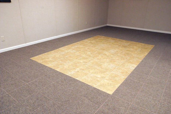 tiled and carpeted basement flooring installed in a Wilmington home